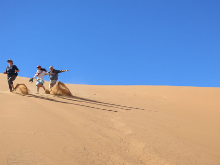 Lydia-Namibia-FAM---running-down-the-sand-dunes